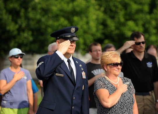 Chief Master Sgt. of the Air Force James Roy salutes during the playing of the national anthem at a Memorial Day ceremony May 30, 2011, at the Air Force Memorial in Arlington, Va.  The ceremony honored the Airmen who gave their lives in the last year.  Those fallen heroes also were honored by wreaths that were presented by Chief Roy and members of several organizations.  (U.S. Air Force photo/Scott M. Ash)