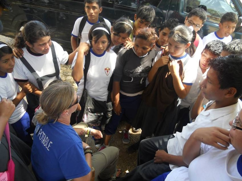 Chana Gwynette, EDGE Outreach, teaches proper hand washing procedures to school children in La Huaca, Peru. (Courtesy photo)