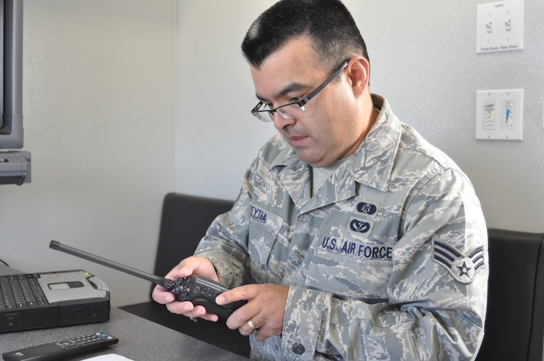 "Senior Airman Joel Aspeytia, 452nd Emergency Management Flight, adjusts a radio during the 3rd Annual Riverside County Multi-Agency Communication Interoperability Test at the Ben Clark Training Center in Riverside, Calif., May 19, 2011.  The test, nicknamed ""Radio Rodeo,"" ensures city, county, state and federal first responder agencies will be able to work together during a major disaster.  (U.S. Air Force photo/ Megan Just)"