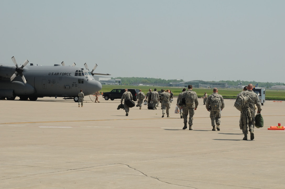 In a Memorial Day sendoff, family members and loved ones gather to bid farewell to members of the 107th Airlift Wing. The Airmen left Niagara Air Reserve Station for their four day journey aboard a C-130 that will eventually land them in Afghanistan for the start of their 90 day tour of duty. (U.S. Air Force photo/Tech Sgt. Catharine Peretta)