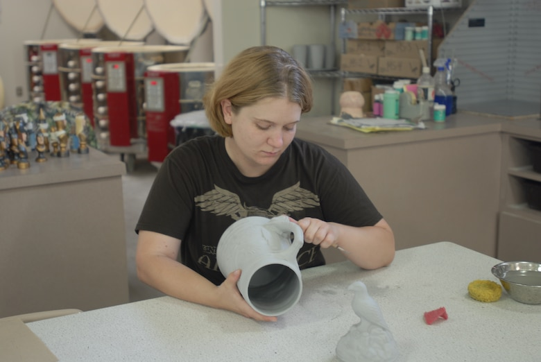 GOODFELLOW AIR FORCE BASE, Texas—Airman 1st Class Jessica Keith, 17th Training Wing Public Affairs, prepares a ceramic stein, a decorative German beer mug, for firing May 21. Firing is the one of the first steps when preparing a ceramic for painting. (U.S. Air Force photo)