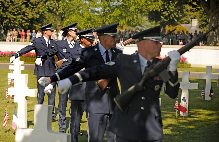 SAINT JAMES, France – Members of the 52nd Fighter Wing Honor Guard firing party fire three volleys during a memorial ceremony at Brittany American Cemetery and Memorial in Saint James, France, May 29. Brittany American Cemetery is the final resting place for 4,410 U.S. service members who died during the Normandy and Brittany campaigns of World War II in 1944. (U.S. Air Force photo/Senior Airman Nathanael Callon)