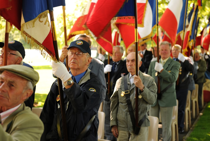 SAINT JAMES, France – French veterans stand for the presentation of the U.S. and French flags during a memorial ceremony at Brittany American Cemetery and Memorial in Saint James, France, May 29. Brittany American Cemetery is the final resting place for 4,410 U.S. service members who died during the Normandy and Brittany campaigns of World War II in 1944. (U.S. Air Force photo/Senior Airman Nathanael Callon)