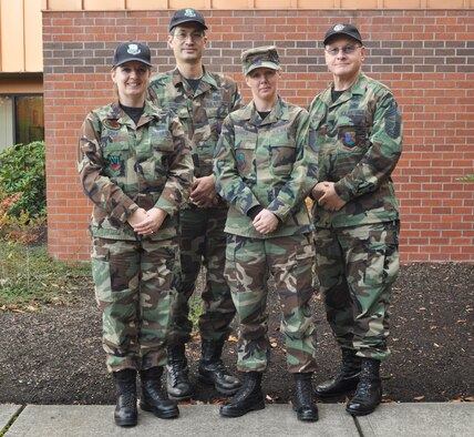 Oregon Air National Guard members wear their Battle Dress Uniform on the last authorized day to wear the BDU, in front of the Oregon Military Department, Oct. 31.  From left to right: Capt. Dawn Choy, Tech. Sgt. Nick Choy, Master Sgt. Sheryl Derrick, Chief Master Sgt. David Gardner.  (U.S. Army photo by Spc. Betty Boyce, Human Resources Benefits Assistant).
