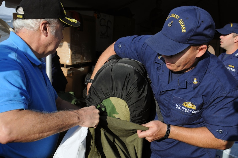 Coast Guard Chief Petty Officer Peter Rossi packs a sleeping bag and blanket into a seabag for homeless members during the Stand Down Against Homelessness at the Armory Park Community Center Oct. 27.  The Ralph H. Johnson Veteran Affairs Medical Center and Goodwill Industries of the Lowcountry sponsored the 12th annual Stand Down Against Homelessness. The event provided medical and dental assistance, clothing, food, haircuts and job and legal counseling for hundreds of homeless in the greater Charleston area.  Rossi is a Boatswain's Mate from U.S. Coast Guard Maritime Law Enforcement Academy Charleston. (U.S. Navy photo/Petty Officer 3rd Class 3rd Class Brannon Deugan)