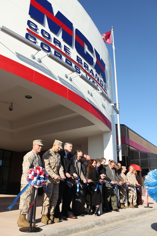 Base officials, service members and Marine Corps Community Services employees combine their ribbon cutting powers at the grand opening of the revamped Marine Corps Exchange aboard Marine Corps Base Camp Lejeune, Nov. 2