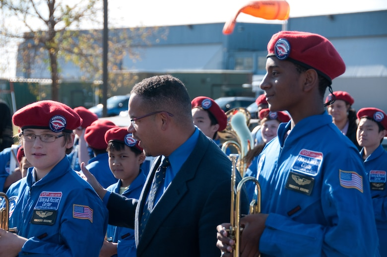 STARBASE launches a new era in education with a ribbon cutting ceremony on Oct. 17, 2011 at the 133rd Airlift Wing base at the Minneapolis - St. Paul international airport. Rep. Keith Ellison thanks students from Farnsworth Aerospace school marching band who came to help open the program. USAF official photo by Senior Airman Jonathan Young