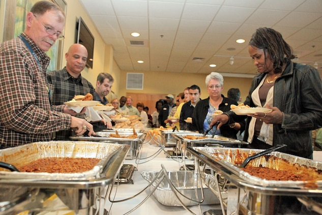 Attendants fill their plates during the Civilian Appreciation Day at Afterburners Nov.3. Many Marine Corps Community Services employees were granted the opportunity to enjoy the afternoon and be acknowledged for their contributions.