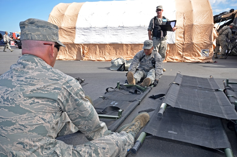 1 Lt. William Crandell (left) and Senior Airman Anthony Ahn from the 141st Medical Squadron prepare stretchers for patient transport during the HRF evaluation. (U.S. Air Force Photo by Staff Sgt. Anthony Ennamorato)