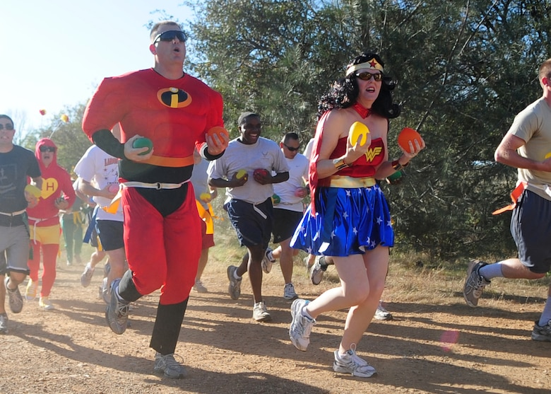 Tech Sgt. Latha Caillouette, dressed as Mr. Incredible, and his wife Tech. Sgt. Reagen Caillouette, 9th Civil Engineer Squadron, participate October 31, 2011, in the Zombie Run at Candy Cane Park at Beale Air Force Base, Calif. in celebration of Halloween. Each participant carried water balloons to douse zombies during the run, which was a first ever for Beale. (U.S. Air Force photo by Airman 1st Class Shawn Nickel/Released)