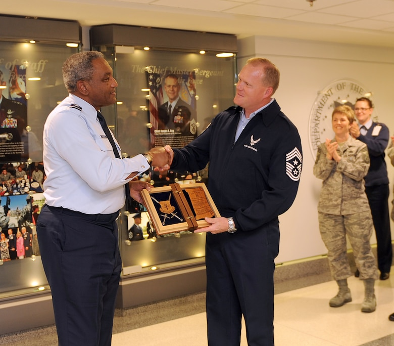 Chief Master Sgt. James Cody, the command chief of Air Education and Training Command, congratulates Maj. Gen. Alfred Flowers, the deputy assistant secretary for budget for the Assistant Secretary of the Air Force for Financial Management and Comptroller office, on his selection as an AETC Order of the Sword recipient. Cody announced the general's selection during a brief ceremony at the Pentagon's Airman's Hall on Nov. 2. (U.S. Air Force photo/Andy Morataya)