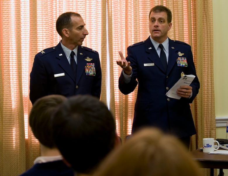 Colonel Leonard Dick, (on left) vice commander, Air National Guard Air Force Reserve Command Test Center, Tucson, Ariz., and Col. Eric Mann, Air National Guard director of requirements, address congressional staffers on Capitol Hill on Oct. 28.  The colonels discussed equipment modernization and the special funding program which Congress specifically provides to the Reserve Component.  The Reserve representatives were hosted by the House National Guard and Reserve Component Caucus and provided an update on cost-effective combat equipment acquisitions that are directly effecting military operations at home and abroad.  (U.S. Air Force photo/Staff Sgt. Tiffany Trojca)