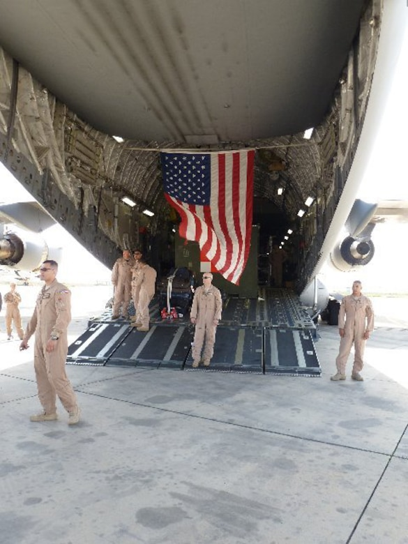 Crew members from the 146th Aeromedial Evacuation Squadron exit a C130 after landing at Tripoli Airport in Libya on October, 29, 2011. The 146th AES was a part of a special mission that helped bring injured Libyan rebels to the United States for medical care.