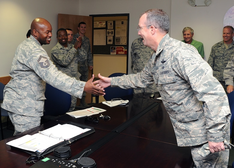 Brig. Gen Paul McGillicuddy, 9th Reconnaissance Wing commander, recognizes Senior Master Sgt. Edward Ames for being selected to promotion to chief master sergeant at Beale Air Force Base, Calif., Nov. 2, 2011. Less than one percent of the Airmen are ever promoted to the rank of E-9. (U.S. Air Force photo by Mr. Sean Bhakta)