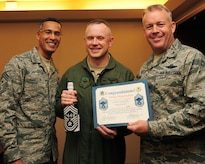 Senior Master Sgt. Philip Hudson poses for a photo with Chief Master Sgt. Terrence Greene and Col. Erik Hansen after being notified he was selected to chief master sergeant. Hudson is the 437th Operations Group C-17 special operations division superintendent, Greene is the 437th AW command chief and Hansen is the 437th AW commander. (U.S. Air Force photo/Staff Sgt. Katie Gieratz)