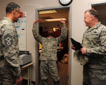 Senior Master Sgt. Terry Jones reacts to finding out he is one of five individuals from Joint Base Charleston to make Chief Master Sgt., Nov. 2, 2011. The selectees were notified by base leadership and a group of Chiefs from around the base. Jones is the host aviation resource management superintendent and is with the 437th Operations Support Squadron. (U.S. Air Force photo/Staff Sgt. Katie Gieratz)(Released)