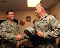 Senior Master Sgt. Jason Winegar shakes hands with Col. Erik Hansen after finding out he was selected for promotion to chief master sergeant Nov. 2. Winegar is the 437th Maintenance Group quality assurance superintendent and Hansen is the 437th Airlift Wing commander. (U.S. Air Force photo/Staff Sgt. Katie Gieratz)