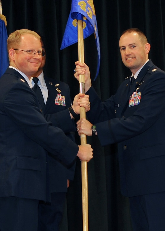 Lt. Col. Matthew Atkins, 25th Intelligence Squadron commander, passes the guidon to Lt. Col. Frederick Humphrey, 43rd Intelligence Squadron commander, during a squadron activation ceremony for the 43 IS at Cannon Air Force Base, N.M., Nov. 1, 2011.  The 43 IS is a tenant squadron here, taking the place of Detachment 1, 25th Intelligence Squadron which was inactivated. (U.S. Air Force photo by Airman 1st Class Xavier Lockley)