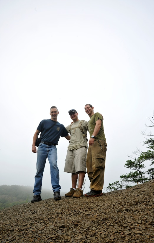 At the end of a group hike, Chaplain (Capt.) Daniel Kamzan, far right, stands proudly atop a mountain in New Castel, Va., with Chaplain (Capt.) Mark Hunsinger, left, 11 WG chaplain, and Staff Sgt. Frank Rivas, middle, 11 WG assistant on Sep. 22. Together, the men participated as mentors in a week-long, JBA Chapel sponsored wilderness retreat which culminated with a two-mile group hike on the last day of the retreat. (U.S. Air Force photo/Airman 1st Class Lindsey A. Beadle)