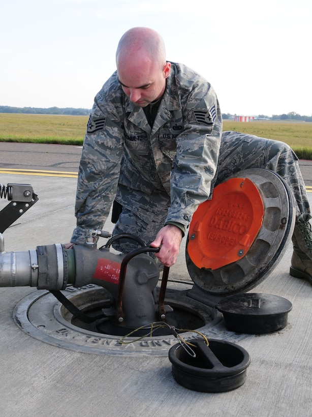 RAF MILDENHALL, England -- Staff Sgt. Chris Schultz, 100th Logistics Readiness Squadron Fuels Management Flight fuels expediter, connects a fuel transport system (pantograph) to refuel a transient aircraft here Oct. 24, 2011. The hydrant outlet is the connection point of the underground pipeline which feeds fuel from storage tanks to the hardstand. Received from a local supplier, fuel is piped to bulk storage containers around base, before being transferred to fuel trucks or piped to storage areas at hardstands. (U.S. Air Force photo/Karen Abeyasekere)
