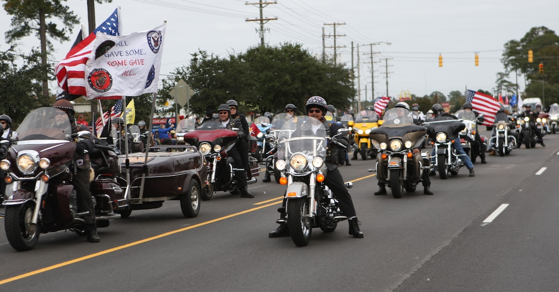 Rolling Thunder Chapter NC-5 cruised in an organized mass during the Veterans Day Parade in Jacksonville, Saturday. More than 2,000 people with various organizations marched to show appreciation and honor to service members and their families.