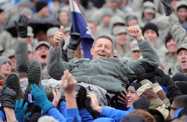 Academy Superintendent Lt. Gen. Mike Gould crowd surfs during the Air Force-Army game at Falcon Stadium Nov. 5, 2011. The Falcons scored 21 points in the third quarter en route to a 24-14 victory over the Black Knights and their second consecutive Commander-in-Chief's Trophy. (U.S. Air Force photo/Tech. Sgt. Raymond Hoy)