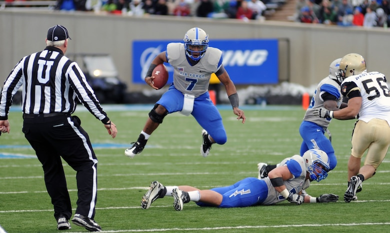 Falcons quarterback Tim Jefferson leaps over his lineman during the Air Force-Army game at Falcon Stadium Nov. 5, 2011. Jefferson finished with 66 yards on 20 rushes with two touchdowns. The Falcons scored 21 points in the third quarter en route to a 24-14 victory over the Black Knights and their second consecutive Commander-in-Chief's Trophy. (U.S. Air Force photo/Tech. Sgt. Raymond Hoy)
