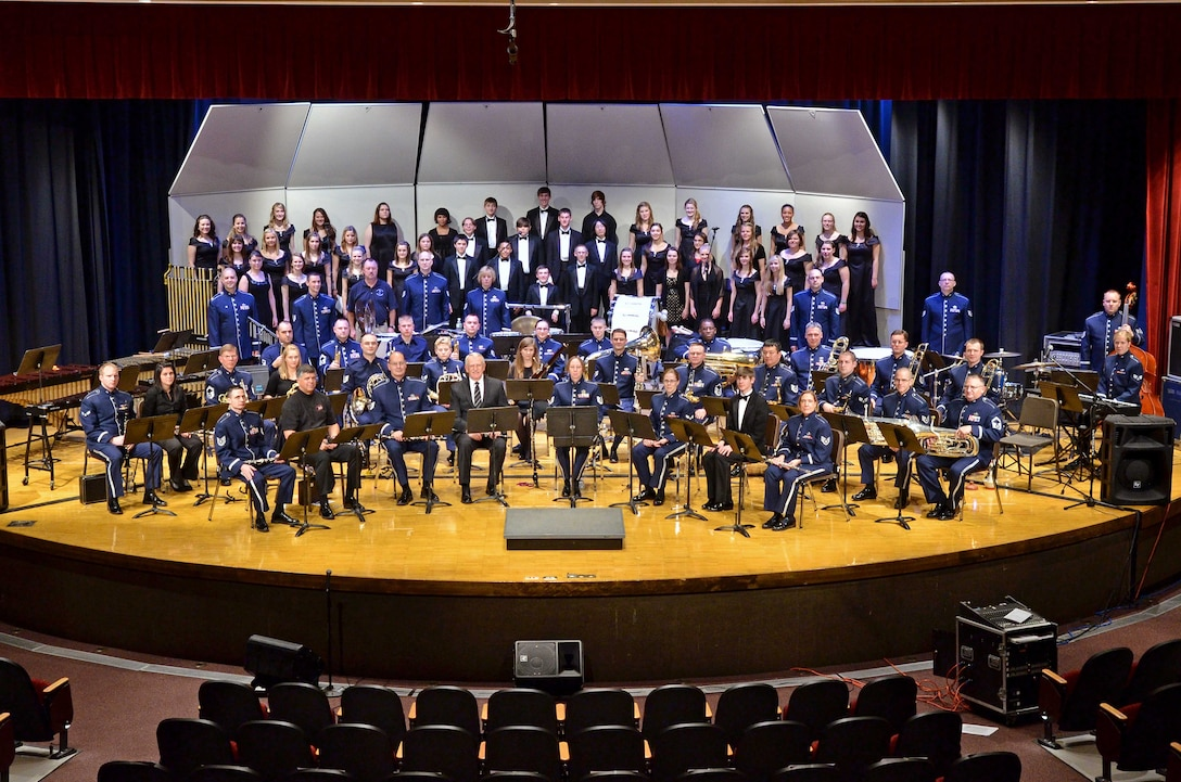 """Members of The Air National Guard Band of the Northwest, also known as the 560th Air Force Band, choir students from Shadle Park and Rogers High Schools, instrumentalists from Coeur D'Alene High School, Eastern Washington University and 560th alumni, pose for a photo before performing a musical """"Salute to Veterans"""" honoring military members past and present in anticipation of Veteran's Day at Spokane Falls Community College.  (U.S. Air Force photo/Staff Sgt. Anthony Ennamorato)"""