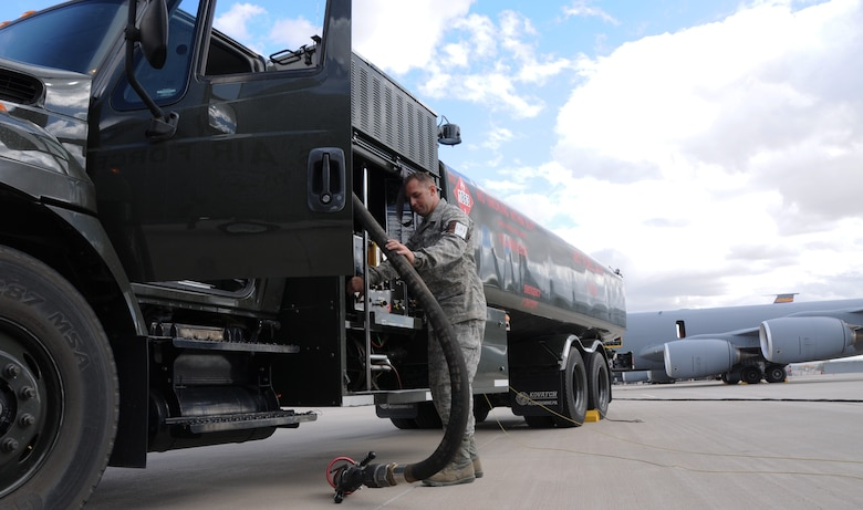 Staff Sgt. Donovan Walden, 161st Logistics Readiness Group fuels technician, wraps up a hose on a fuel truck as part of a routine inspection during an aircraft generation exercise, Phoenix, Nov. 5, 2011. In order to maintain safety on the flightline, these six thousand gallon fuel trucks are inspected daily for leaks and cracks in the pipes. (U.S. Air Force Photo by Staff Sgt. Courtney Enos/Released)