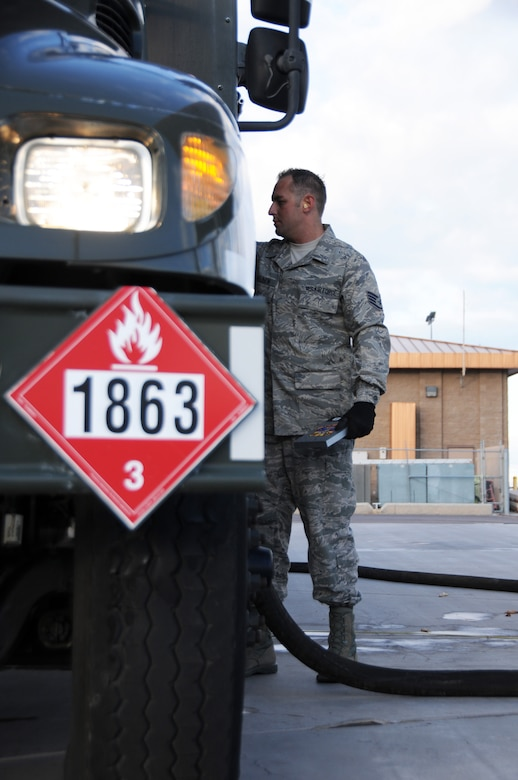 Staff Sgt. Donovan Walden, 161st Logistics Readiness Group fuels technician, monitors the gauges on a fuel truck as part of a routine inspection during an aircraft generation exercise, Phoenix, Nov. 5, 2011. In order to maintain safety on the flightline, these six thousand gallon fuel trucks are inspected daily for leaks and cracks in the pipes. (U.S. Air Force Photo by Staff Sgt. Courtney Enos/Released)