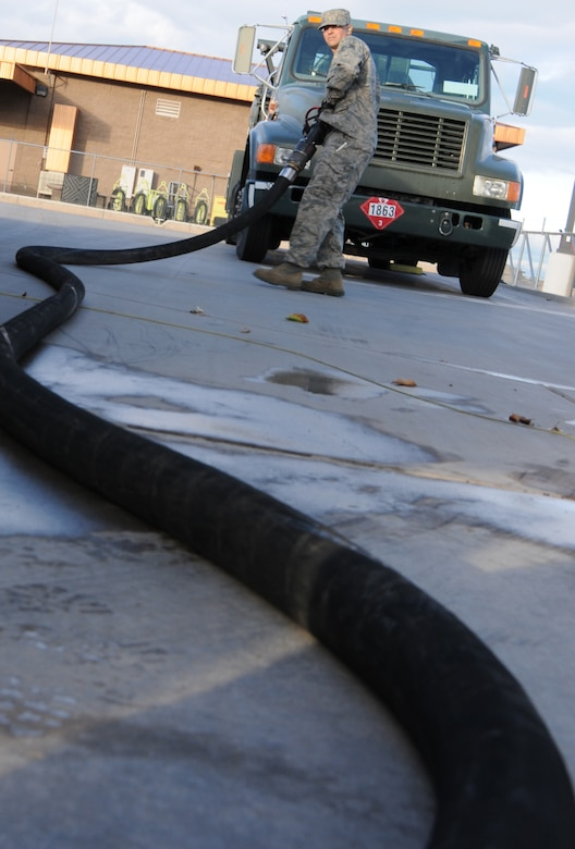 Staff Sgt. Matthew Salamone, 161st Logistics Readiness Group fuels technician, pulls a fuel hose on a fuel truck as part of a routine inspection during an aircraft generation exercise, Phoenix, Nov. 5, 2011. In order to maintain safety on the flightline, these six thousand gallon fuel trucks are inspected daily for leaks and cracks in the pipes. (U.S. Air Force Photo by Staff Sgt. Courtney Enos/Released)