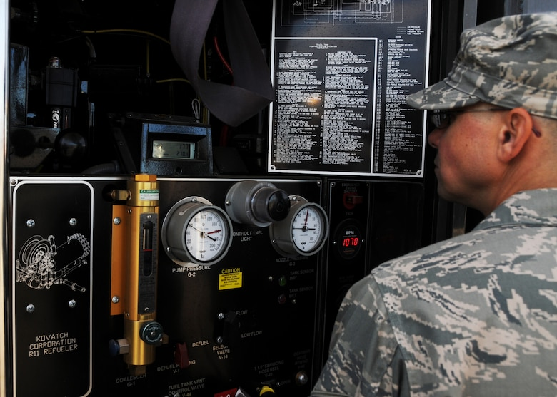 Staff Sgt. Matthew Salamone, 161st Logistics Readiness Group fuels technician, monitors the gauges on a fuel truck as part of a routine inspection during an aircraft generation exercise, Phoenix, Nov. 5, 2011. In order to maintain safety on the flightline, these six thousand gallon fuel trucks are inspected daily for leaks and cracks in the pipes. (U.S. Air Force Photo by Staff Sgt. Courtney Enos/Released)