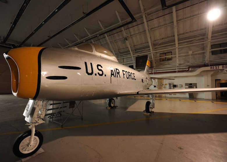 A static F-86 Saberjet sits in an aircraft shelter at Hancock Field Air National Guard Base, Syracuse, NY after being recently refurbished by the 174th Fighter Wing Maintenance Group. This is one of 10 different aircraft employed by the 174 FW since its formation in 1947 (including the MQ-9 Reaper and RC-26 which it currently flies). In the future, these aircraft will be pre-positioned permanently at an air park on base where they will be on display for future generations to view.