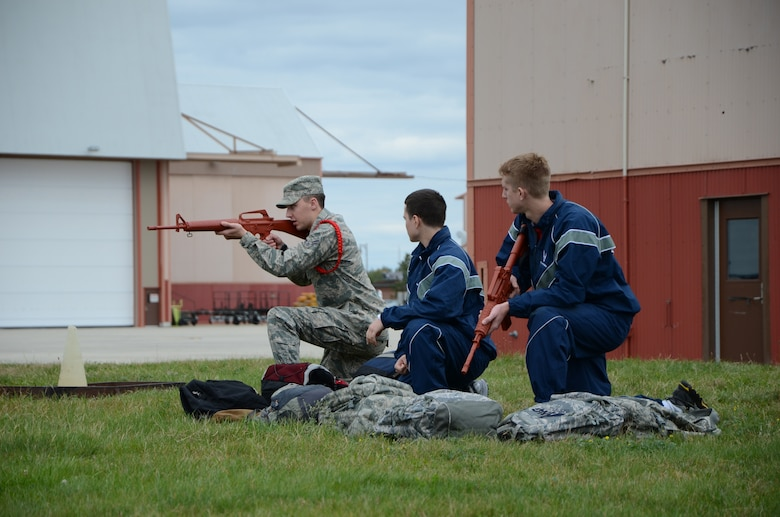 Members of the 157th Air Refueling Wing's student flight train on mock M-4 rifles during defensive fighting position drills,  Pease Air National Guard Base, New Hampshire, October 23, 2011.  (U.S. Air Force photo/2nd Lt. Alec C. Vargus)