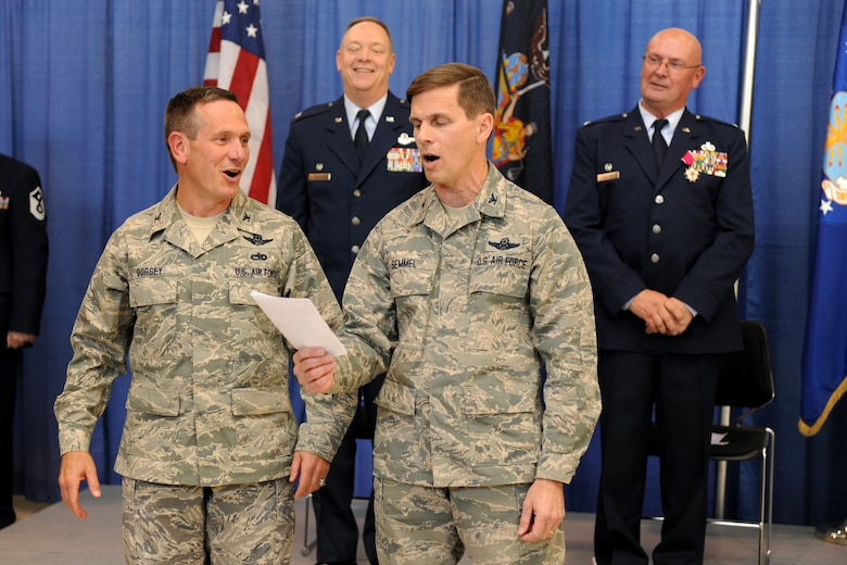 U.S. Air Force Col. Charles Dorsey (front left) and Col. Greg Semmel, both graduates of the U.S. Air Force Academy, lead the singing of the Air Force Song during the retirement ceremony for Col. Harvey Van Wie (back right) held 5 November 2011 at Hancock Field Air National Guard Base, Syracuse, NY.  Col. Van Wie reached the rank of Senior Master Sgt. in the 174th Fighter Wing before becoming a commissioned officer. His last job with the wing was as Mission Support Group commander.