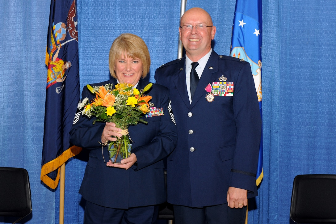 U.S. Air Force Chief Master Sgt. Judy Van Wie (retired) and Col. Harvey Van Wie Col. Harvey (retired) are all smiles during a retirement ceremony held for Col. Van Wie on 5 November 2011 at Hancock Field Air National Guard Base, Syracuse, NY. Col. Van Wie enlisted in the Air Force in 1970 and was the last member of the 174th Fighter Wing to have served in the Vietnam War.