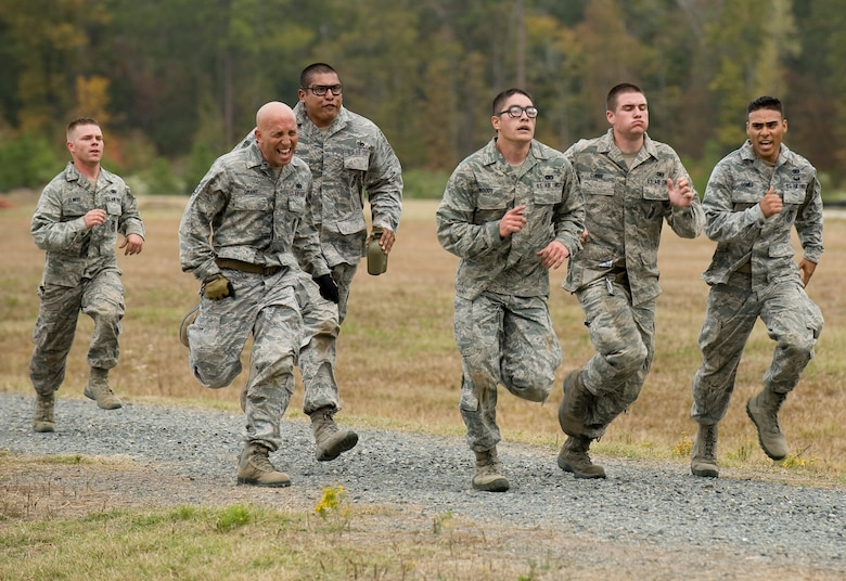 Members of the 90th Security Forces Group sprint toward the finish line of the mental and physical challenge portion of the 2011 Air Force Global Strike Challenge on Camp Minden, La., Nov. 7. The MAP challenge consisted of seven consecutive events designed to test each team's ability to work together. (U.S. Air Force photo/Senior Airman Chad Warren)(RELEASED)