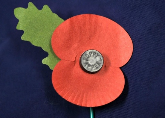 The wearing of poppies is a proud tradition in the U.K.. Today the artificial poppies are made at the Poppy Factory in Surrey, England and Remembrance Sunday is the culmination of a year's effort to make 38 million Remembrance poppies, 5 million Remembrance petals, 900,000 crosses and 100,000 wreaths. A team of 50 people , most of them disabled and ex-servicemen and women, work all year round. They also make wreaths laid by Her Majesty the Queen and other members of the Royal Family. (US Air Force photo y Airman 1st Class Eboni Knox)