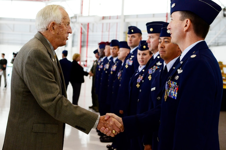 Lt. Col. Jay Craddock (retired) presents the Distinguished Flying Cross with Valor to Airmen at Moffett Federal Airfield, Calif., Nov. 5, 2011. Craddock is a former group commander at the 129th Rescue Wing. 129th Rescue Wing Airmen heroically performed combat rescue missions in Afghanistan, often under hostile fire, in 2009 and 2010. Because of these actions they received the Distinguished Flying Cross, a medal awarded to servicemembers who distinguish themselves in support of operations by heroism or extraordinary achievement while participating in an aerial flight. (Air National Guard photo by Airman 1st Class John Pharr)