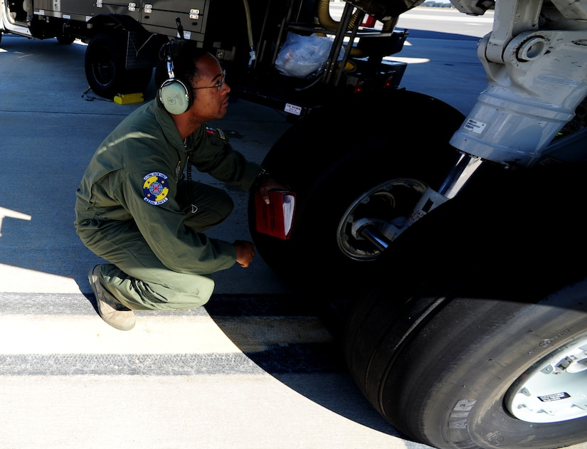 Staff Sgt. Kevin Sumlin performs a pre-flight inspection on the front tires of  a C-17 Globemaster III before a mission at Joint Base Charleston - Air Base Nov. 2.  The Flying Crew Chiefs Office is a special duty assignment designed to provide a flying mission with a single-person maintenance package. Sumlin is a Flying Crew Chief with the 437th Aircraft Maintenance Squadron.  (U.S. Air Force photo/ Staff Sgt. Nicole Mickle)