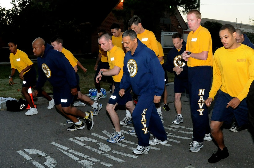 Naval Support Activity personnel begin the mile and half run for the Physical Readiness Test at Joint Base Charleston-Weapons Station Nov. 3.  The PRT, conducted twice a year, consists of a cardiovascular test, push-ups and sit-ups and tests each Sailor's cardio-respiratory endurance, muscular strength and stamina performance. (U.S. Navy photo/Petty Officer 3rd Classs Brannon Deugan)