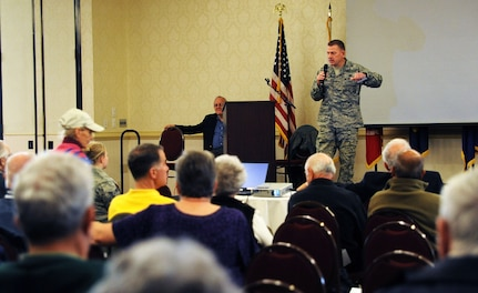 Col. Richard McComb addresses retirees and their spouses at the Retiree and Spouse Information Fair at the Charleston Club on Joint Base Charleston - Air Base, Nov. 5. The fair was held to inform retirees about their benefits and services available on JB Charleston. McComb is the Joint Base Charleston commander. (U.S. Air Force photo/Airman 1st Class Ashley Galloway)
