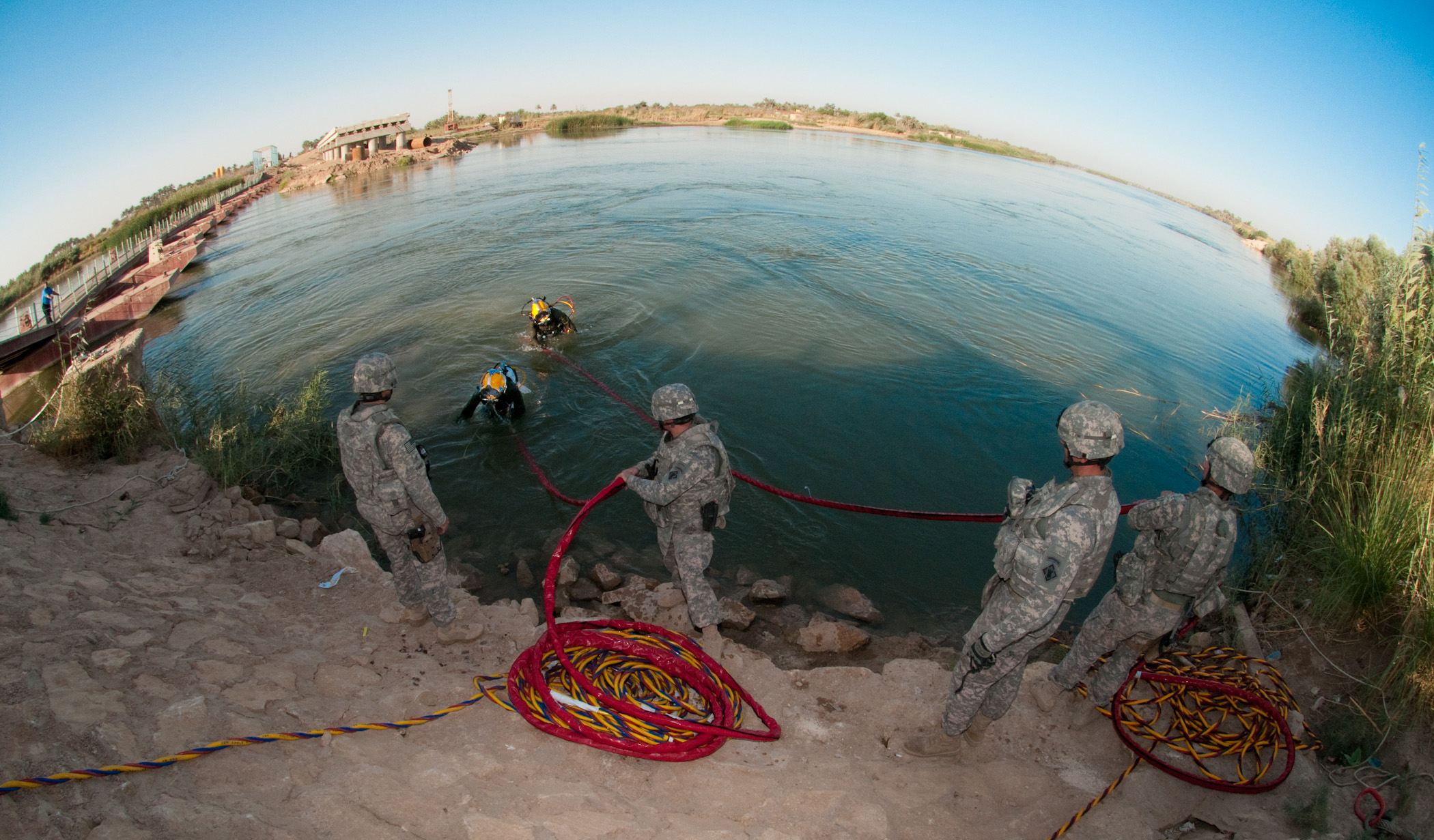 Divers with the 86th Engineer Dive Team exit the Euphrates