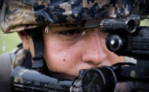 ANDERSEN AIR FORCE BASE, Guam—Airman 1st Class Israel Garcia, 36th Security Forces Squadron member, looks down the sights of an M4 assault rifle during training at the  Pacific Air Forces Regional Training Center here, Nov. 7. Each defender in training was taught war-fighting techniques by cadres assigned to the 736th Security Forces Squadron Commando Warrior Flight. (U.S. Air Force photo by Senior Airman Benjamin Wiseman/Released)