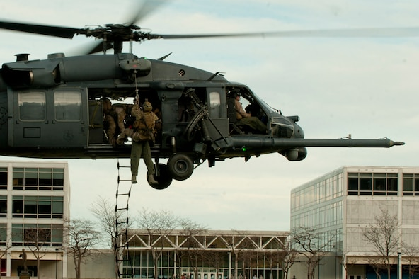 An HH-60G Pave Hawk from the 66th Rescue Squadron out of Nellis Air Force Base, Nev., 58th Rescue Squadron out of Nellis Air Force Base, Nev. a geographically separated unit (GSU) of the 23d Wing at Moody Air Force Base, Ga., hovers as a simulated downed pilot is hoisted up during a personnel recovery demonstration for the U.S. Air Force Academy in Colorado Springs, Colo., Nov. 4, 2011. The demonstration consisted of multiple squadrons from the 23rd Wing working together to secure an area and retrieve the pilot. It took under two minutes for the team to secure, retrieve, and evacuate the downed pilot. (U.S. Air Force photo by Staff Sgt. Joshua J. Garcia/Released)