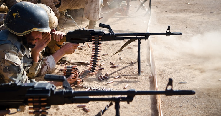 Students fire PKM general purpose machine guns during the firearms training portion of the Tactical Leaders Course aboard Camp Leatherneck, Helmand province, Nov. 1. The Joint Sustainment Academy Southwest has started a new course of training with various Afghan security forces with the idea of working together to accomplish a mission.