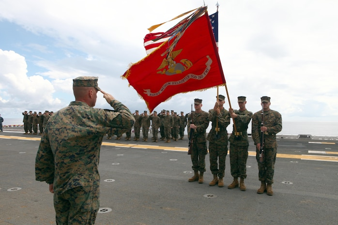 Lt. Col. Damien Marsh, the commanding officer of Marine Medium Helicopter Squadron 265 (Reinforced), 31st Marine Expeditionary Unit, salutes the colors during a birthday ceremony celebrating the Marine Corps 236th year. The 31st MEU is the nation's only continually forward deployed MEU, and remains the United States' force in readiness in the Asia-Pacific region.