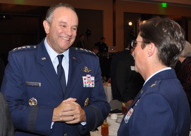 Air Force Vice Chief of Staff Gen. Phil Breedlove talks with Brig. Gen. Theresa Carter, 502nd Air Base Wing commander, before the Spirit of America dinner in San Antonio, Texas, Nov. 9, 2011.  Breedlove was the keynote speaker at the dinner, which was part of San Antonio's annual Celebrate America's Military tribute. (U.S. Air Force photo/Dianne Moffett)
