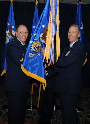 Lt. Gen. Charles Stenner, Jr., Chief of Air Force Reserve, Headquarters U.S. Air Force, Washington, D.C., and Commander, Air Force Reserve Command, Robins Air Force Base, Ga., passes the guidon to Brig Gen William Binger as he transfers command of Tenth Air Force located at the Naval Air Station Fort Worth Joint Reserve Base, Texas. Binger assumed command from Maj. Gen. Frank J. Padilla after two and a half years at 10th AF on Nov. 5.