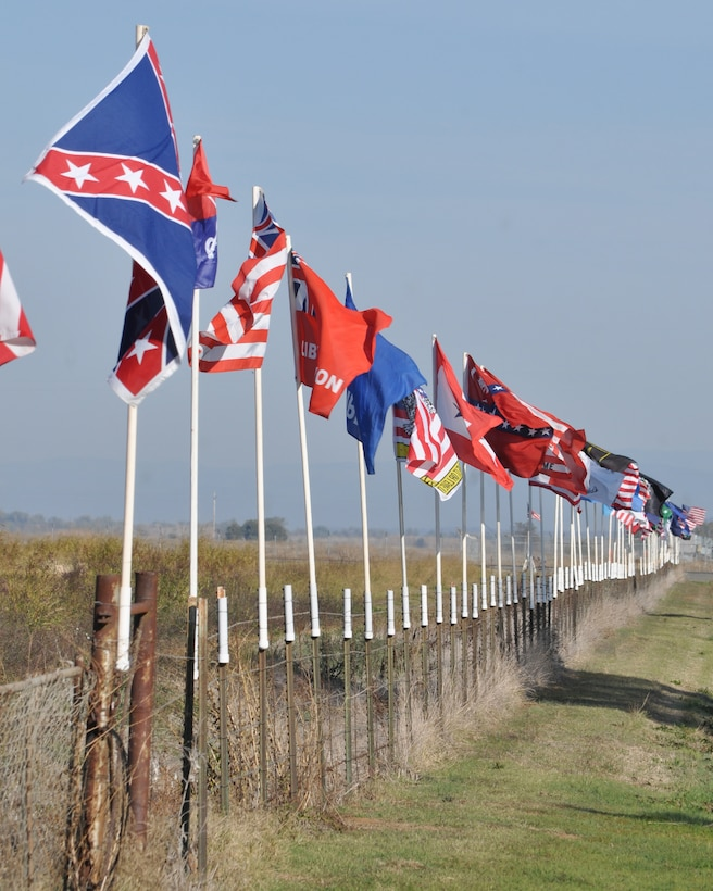 Flags flap in the wind outside of the Museum of the Forgotten Warrior near Beale Air Force Base, Calif., Nov. 10, 2011. The museum houses items and uniforms from all branches of services and periods honoring military members who have been lost during the various wars the United States have fought.  (U.S. Air Force photo by Staff Sgt. Jonathan Fowler/Released)